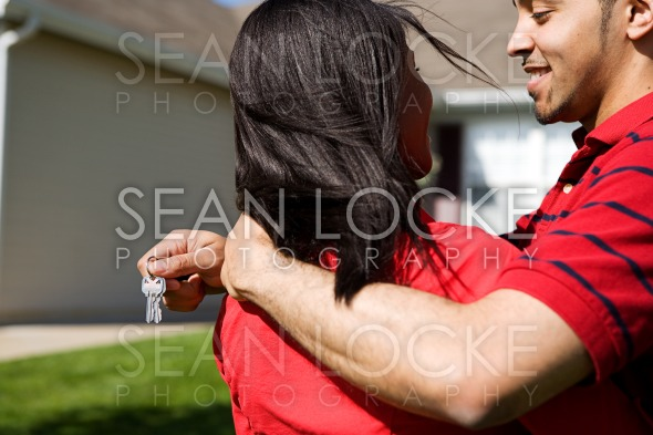 Home: Couple Happy to Have New Home Stock Photography Content by Sean Locke