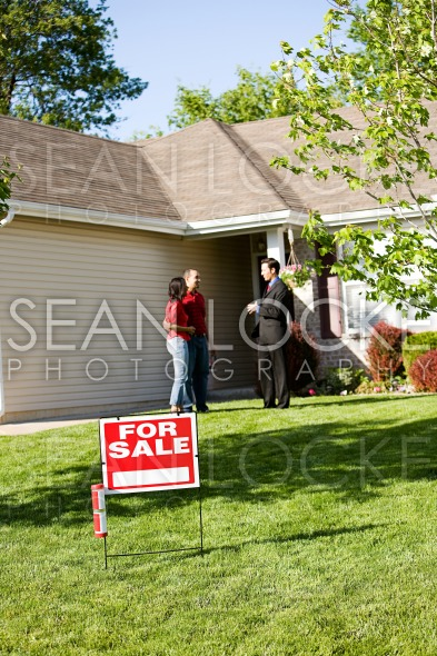 Home: Couple Attend Open House Stock Photography Content by Sean Locke