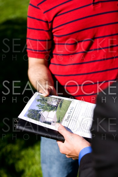 Home: Looking at a Home Brochure Stock Photography Content by Sean Locke