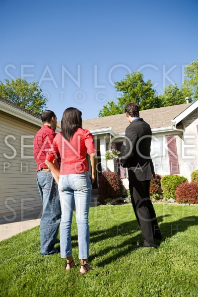 Home: Agent Shows Home to Couple Stock Photography Content by Sean Locke