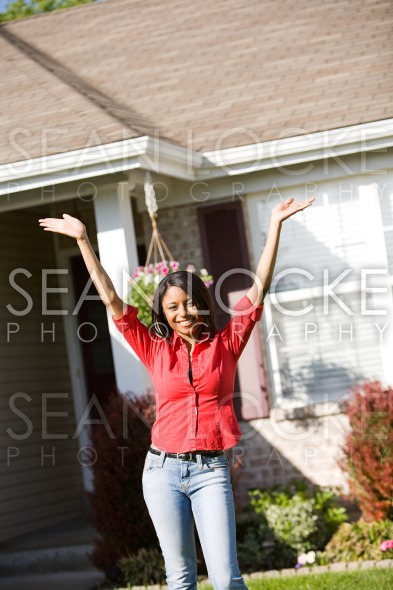 Home: Excited Woman Outside of Home Stock Photography Content by Sean Locke