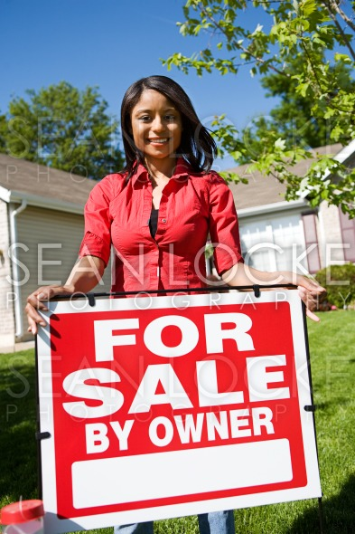 Home: Woman Wants to Sell Home Stock Photography Content by Sean Locke