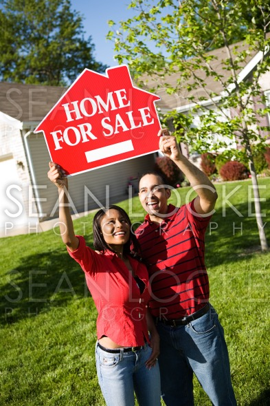 Home: Couple Holds Up For Sale Sign Stock Photography Content by Sean Locke
