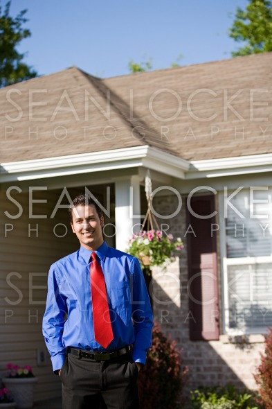 Home: Smiling Real Estate Agent Stock Photography Content by Sean Locke