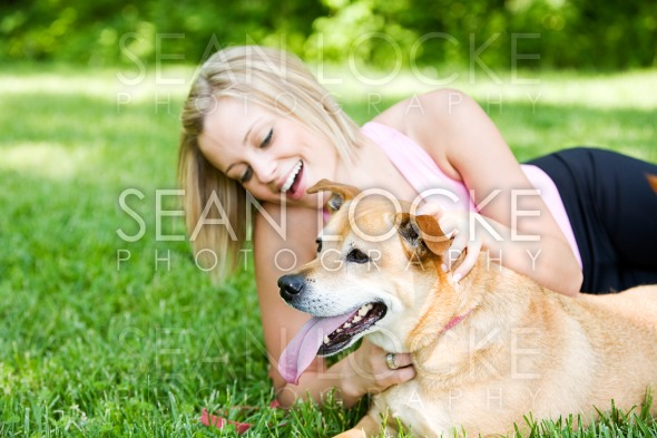 Park: Owner Laughing and Playing with Pet Stock Photography Content by Sean Locke