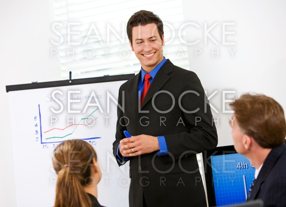 Business: Man Reviews Sales Numbers For Team Stock Photography Content by Sean Locke