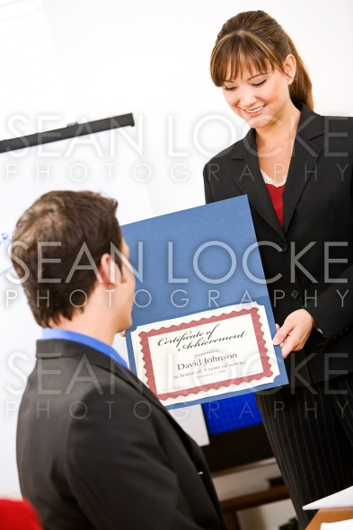 Business: Manager Presents Employee with Award Stock Photography Content by Sean Locke