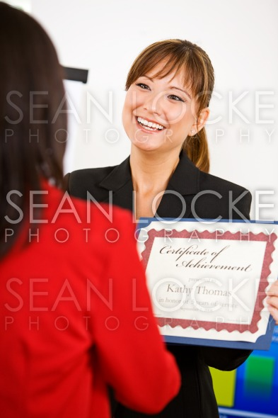 Business: Manager Presents Certificate To Employee Stock Photography Content by Sean Locke