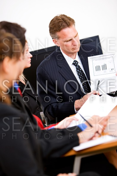 Business: Manager Going Through Documents Stock Photography Content by Sean Locke