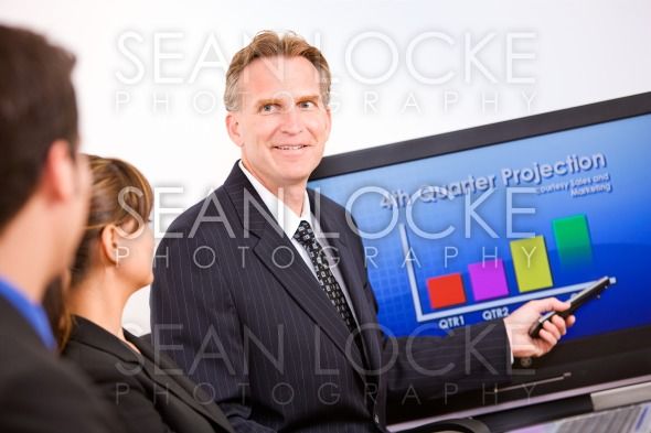 Business: Manager Reviewing Sales Projections Stock Photography Content by Sean Locke