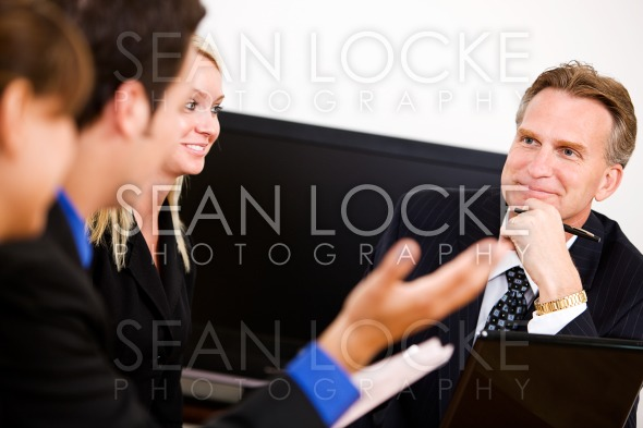 Business: Manager Amused By Discussion Stock Photography Content by Sean Locke