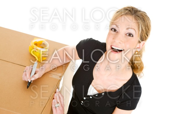 Boxes: Woman Writing On Box Stock Photography Content by Sean Locke