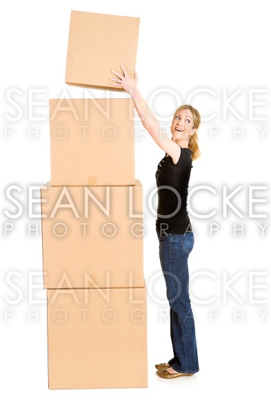 Boxes: Woman Laughs While Stacking Boxes Stock Photography Content by Sean Locke
