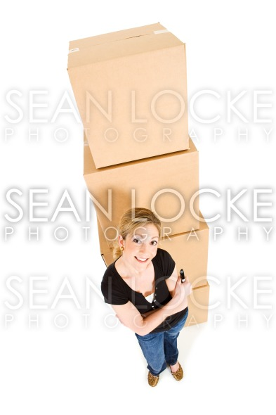 Boxes: Woman With Marker By Stack Of Boxes Stock Photography Content by Sean Locke