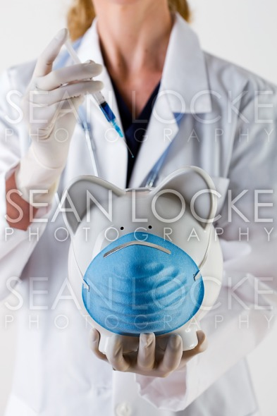 Healthcare: Giving Shot To Sick Piggy Bank Stock Photography Content by Sean Locke