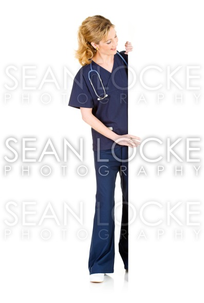 Doctor: Standing Behind White Card and Looking To Blank Area Stock Photography Content by Sean Locke