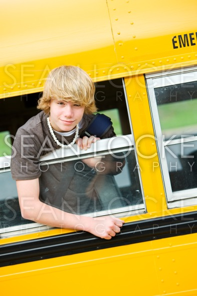 School Bus: Boy Leaning Out Bus Window Stock Photography Content by Sean Locke