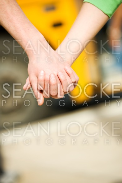School Bus: Focus on Holding Hands Stock Photography Content by Sean Locke