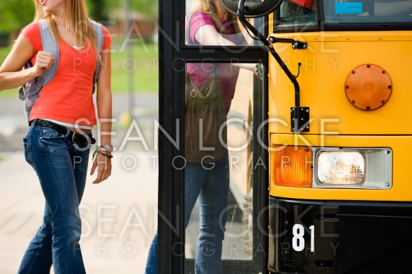 School Bus: Anonymous Students Boarding Bus Stock Photography Content by Sean Locke