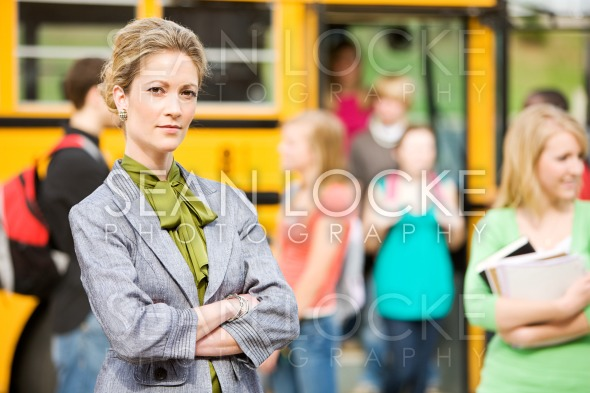 School Bus: Stern Teacher At Bus Arrival Stock Photography Content by Sean Locke