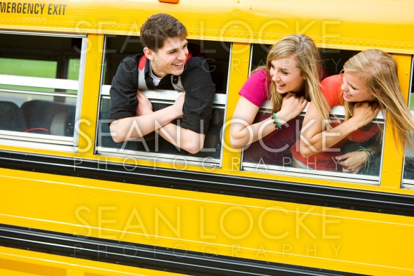 School Bus: Teens Leaning Out Bus Window Stock Photography Content by Sean Locke