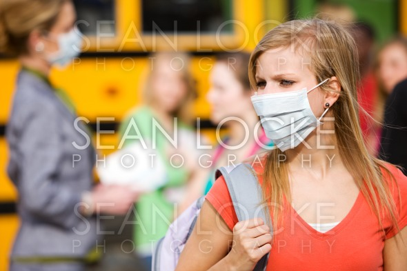 School Bus: Girl Has to Wear Mask to Avoid Disease Stock Photography Content by Sean Locke