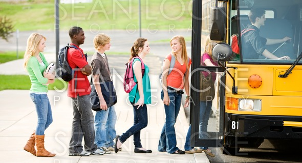 School Bus: Line of Students Boarding Bus Stock Photography Content by Sean Locke