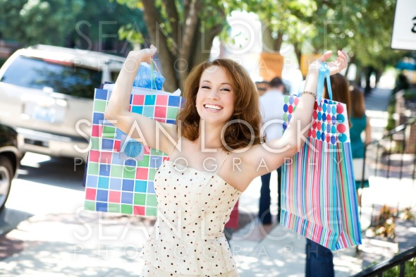 Boutique: Pretty Woman Having a Great Shopping Day Stock Photography Content by Sean Locke
