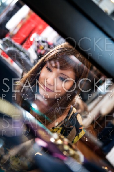 Boutique: Customer Looks Through Glass At Jewelry Stock Photography Content by Sean Locke