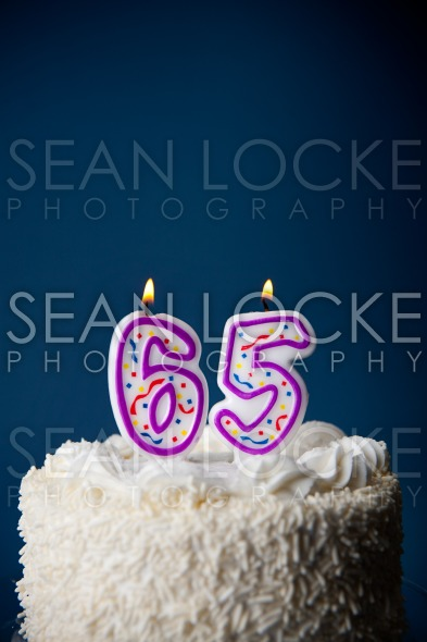 Cake: Birthday Cake With Candles For 65th Birthday Stock Photography Content by Sean Locke