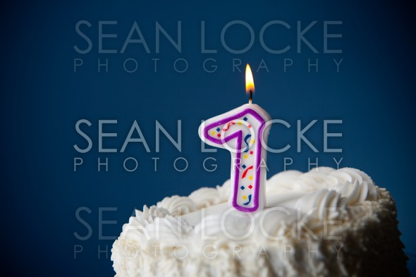 Cake: Birthday Cake With Candles For 7th Birthday Stock Photography Content by Sean Locke