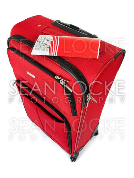 Baggage: Red Suitcase Isolated on White Stock Photography Content by Sean Locke