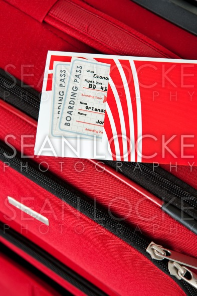 Baggage: Red Suitcase With Airline Ticket On Top Stock Photography Content by Sean Locke