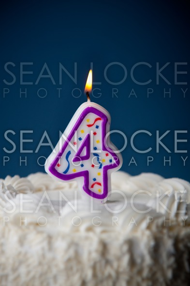 Cake: Birthday Cake With Candles For 4th Birthday Stock Photography Content by Sean Locke