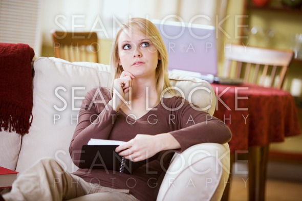 At Home: Woman Trying To Remember Schedule Dates Stock Photography Content by Sean Locke