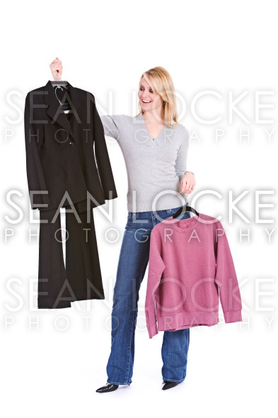 Choices: Woman Deciding Between Fancy Suit Or Lazy Sweatshirt Stock Photography Content by Sean Locke