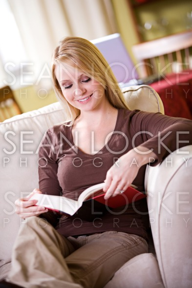 At Home: Woman Takes Time Out To Read Novel Stock Photography Content by Sean Locke