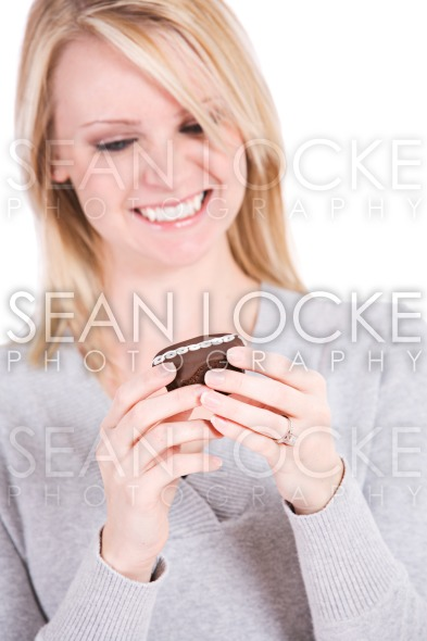 Choices: Woman Wants To Eat Snack Cupcake Stock Photography Content by Sean Locke
