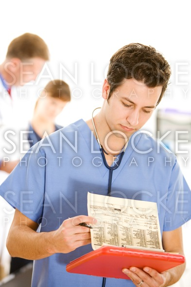Doctors: Doctor Reading Test Results Stock Photography Content by Sean Locke