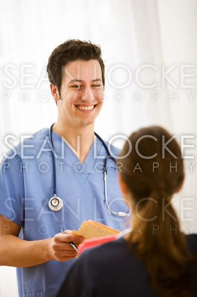 Doctors: Talking with Fellow Health Professional Stock Photography Content by Sean Locke