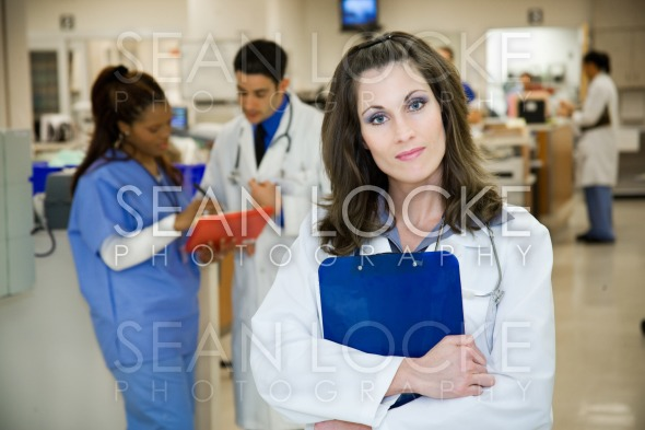 Hospital: Serious Hispanic Doctor in Emergency Room Stock Photography Content by Sean Locke
