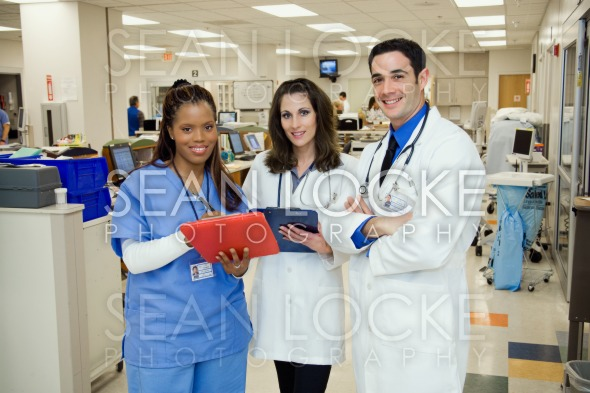 Hospital: Medical Team Standing In Emergency Room Stock Photography Content by Sean Locke
