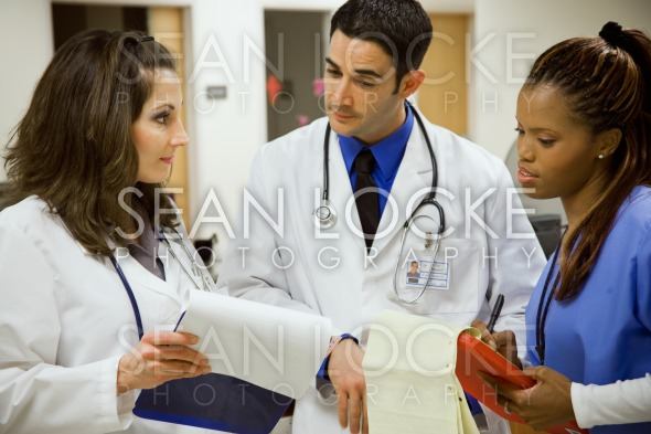 Hospital: Multi-Ethnic Medical Team At Work Stock Photography Content by Sean Locke