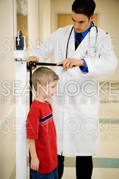 Hospital: Boy Stands Still To Have Height Measured Stock Photography Content by Sean Locke