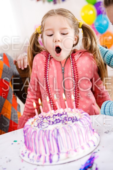 Birthday: Girl Makes Birthday Wish And Blows Stock Photography Content by Sean Locke