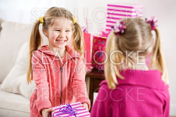 Birthday: Girl Gets Present From Friend Stock Photography Content by Sean Locke