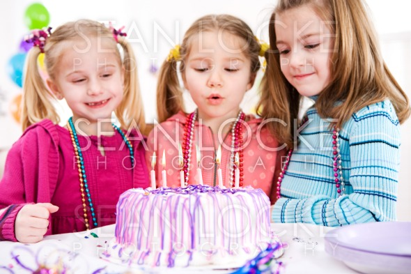 Birthday: Focus on Lit Birthday Candles Stock Photography Content by Sean Locke