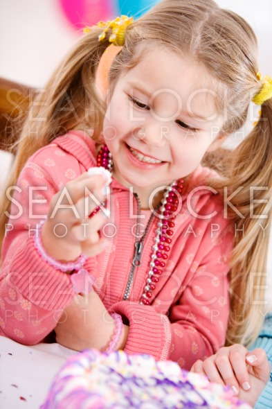 Birthday: Girl Takes a Sneak Taste Of Frosting Stock Photography Content by Sean Locke