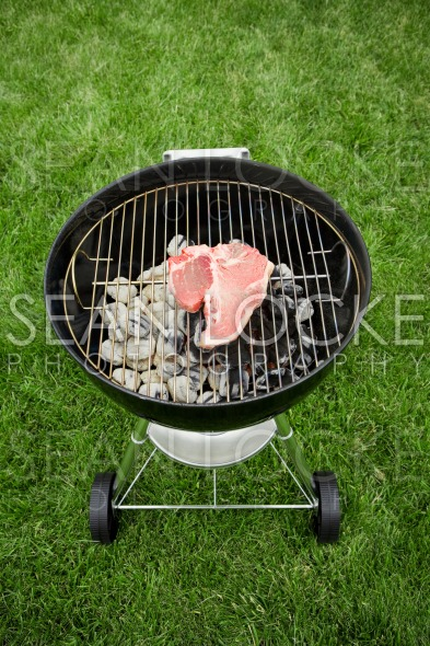Barbeque: Raw Steak on Grill Stock Photography Content by Sean Locke