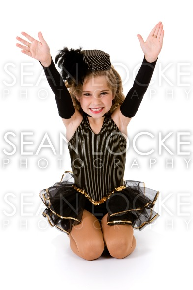 Dance: Girl Tap Dancer in Fancy Costume Does Tah-Dah Stock Photography Content by Sean Locke